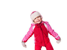 The laughing girl wearing red overalls and mittens Stock Image