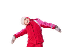 The laughing girl wearing red overalls and mittens Royalty Free Stock Images