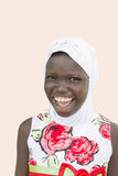 Laughing girl wearing a white hijab and a colourful dress, ten years old. Laughing girl wearing a white hijab and a  colourful dress, ten years old Royalty Free Stock Photos