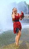 Laughing girl in wet clothes Royalty Free Stock Image