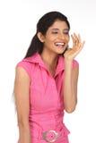 Laughing Girl in whispering pose Stock Image