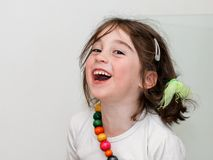 Laughing girl in white shirt Royalty Free Stock Photos