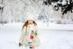 Laughing girl in winter park. Happy holiday and childhood concep Stock Image