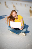 Laughing Girl With Notebook Royalty Free Stock Photo