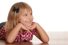 Laughing girl on the wooden floor Stock Images