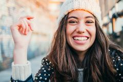 Laughing girl with woolen cap. Portrait of a happy and beautiful young woman with woolen cap and lleather jacket laughing royalty free stock photography