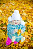 Laughing Girl With Yellow Leaf Royalty Free Stock Photography