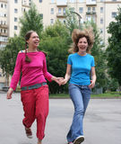Laughing girlfriends Stock Photos