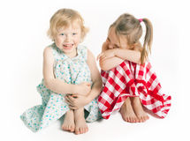 Laughing girls. Two 3 years old girls laughing in studio Stock Photos