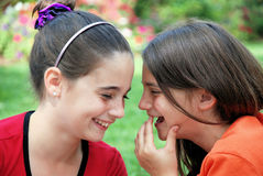 Laughing Girls. Two schoolgirls laughing and talking together Royalty Free Stock Photo