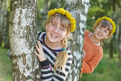 Laughing girls outdoors Royalty Free Stock Image