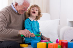 Laughing with granddad Royalty Free Stock Photography