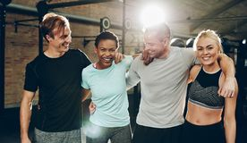Group of friends laughing after working out at the gym
