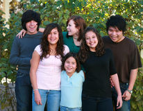 Laughing group of kids. Diverse group of multi-ethnic real people teens Stock Image