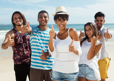 Laughing group of multiethnic man and women at beach Royalty Free Stock Photography