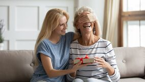 Free Laughing Grownup Daughter Congratulates Mature Mother Giving Her Birthday Surprise Royalty Free Stock Photos - 197373878