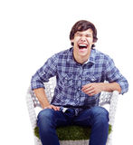 Laughing guy in armchair Royalty Free Stock Photo