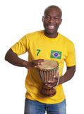 Laughing guy from Brazil with drum supporting his team Royalty Free Stock Images