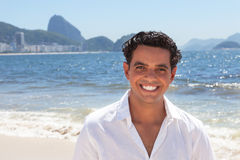 Laughing guy at Copacabana beach at Rio de Janeiro Stock Images