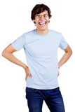 Laughing guy in glasses with arms akimbo over white Stock Images