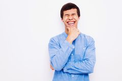 Laughing guy with hand on his chin Royalty Free Stock Photos