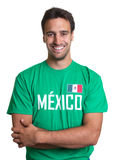 Laughing guy in a mexican jersey with crossed arms. Laughing guy in a mexican soccer jersey with crossed arms on an isolated white background Stock Photo