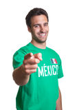Laughing guy in a mexican jersey pointing at camera Stock Images