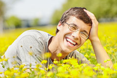 Laughing guy in spring meadow Stock Photos