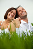 Laughing hand holding couple Stock Image