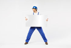 Laughing handsome builder with white banner Royalty Free Stock Photos