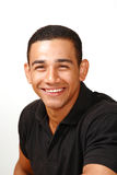 Laughing handsome latino male. In vertical portrait Royalty Free Stock Photography