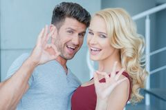 Laughing happy couple making Perfect gestures Stock Image