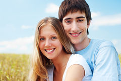 Laughing happy couple over blue sky Stock Images