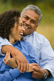 Laughing happy hispanic couple. Attractive couple laughing together outdoors Royalty Free Stock Photo