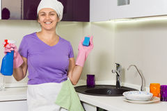 Laughing happy housewife working in the kitchen Royalty Free Stock Image