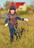 Laughing Happy little girl running in sunlight on the meadow. Stock Photo