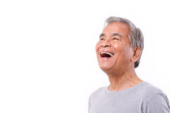 Laughing, happy senior old man looking up. White isolated background stock image