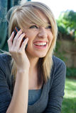 Laughing happy Teenager on Mobile Cell Phone Royalty Free Stock Photography