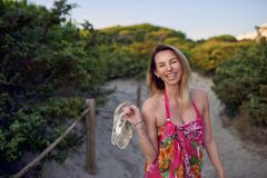 Laughing happy vivacious woman on summer vacation Stock Images