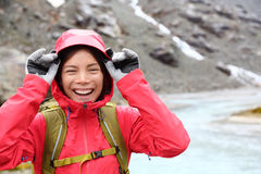 Laughing happy woman hiking with backpack in rain Royalty Free Stock Photo