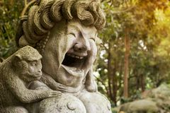 Laughing Happy Woman Sculpture With Monkey In Ubud Royalty Free Stock Photography