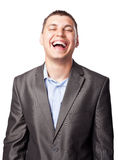 Laughing happy young businessman Royalty Free Stock Image