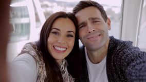 Laughing happy young couple taking their selfie stock video footage