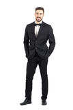 Laughing happy young man in tuxedo with bow tie looking at camera Stock Photography
