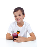 Laughing healthy boy with fresh juice Royalty Free Stock Images