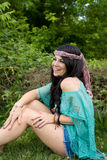 Laughing Hippie Girl. A portrait of a beautiful young woman, dressed in hippie fashion, laughing Stock Image