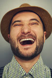 Laughing hipster man over grey Royalty Free Stock Photo