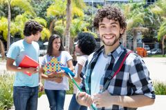 Laughing hipster student with group of friends Royalty Free Stock Photo