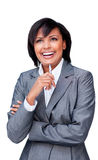Laughing Hispanic businesswoman holding a pen Stock Images