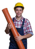 Laughing hispanic construction worker with water pipe Stock Images